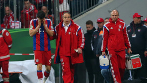 Bayern striker Robert Lewandowski goes off the field after sustaining a head injury in the german cup defeat by Dortmund