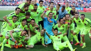 The Barcelona players celebrate clinching the Spanish league title